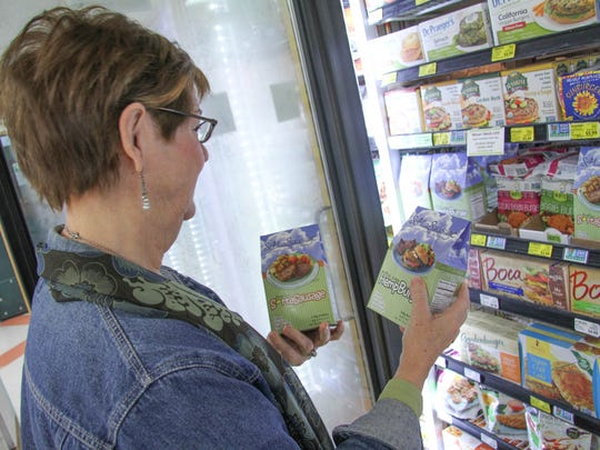 Ainsley checks out her products on display in the frozen section at LifeSource.