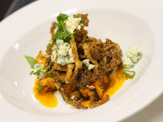 A Trails and Trotters Pork Osso Bucco and Sweet Potato Hash with Rogue Creamery Smoky Blue Cheese and Tobacco Onions was one of the courses at the Pairings Wine and Food Experience at Willamette Valley Vineyards on March 6.