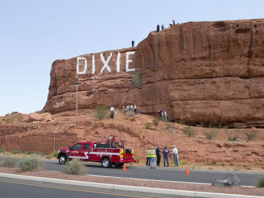 A 14-year-old girl from Salt Lake City got her hair stuck on climbing equipment while rappelling down Dixie Rock Thursday.