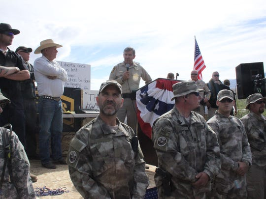 Then Clark County Sheriff Doug Gillespie speaks while Cliven Bundy watches and militia men stand guard in 2014.