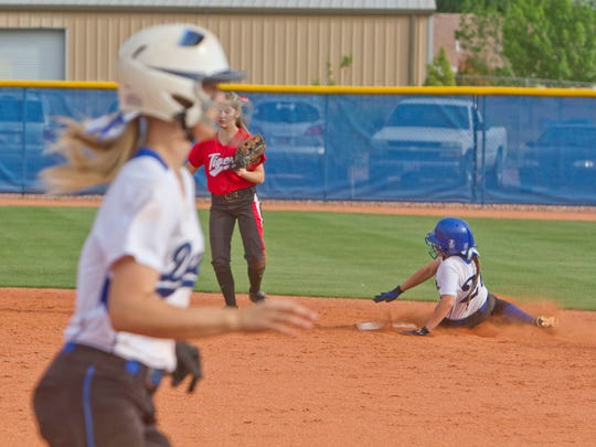 Dixie outfielder Jaylee Stratton slides into second base during their game against Hurricane on Wednesday.