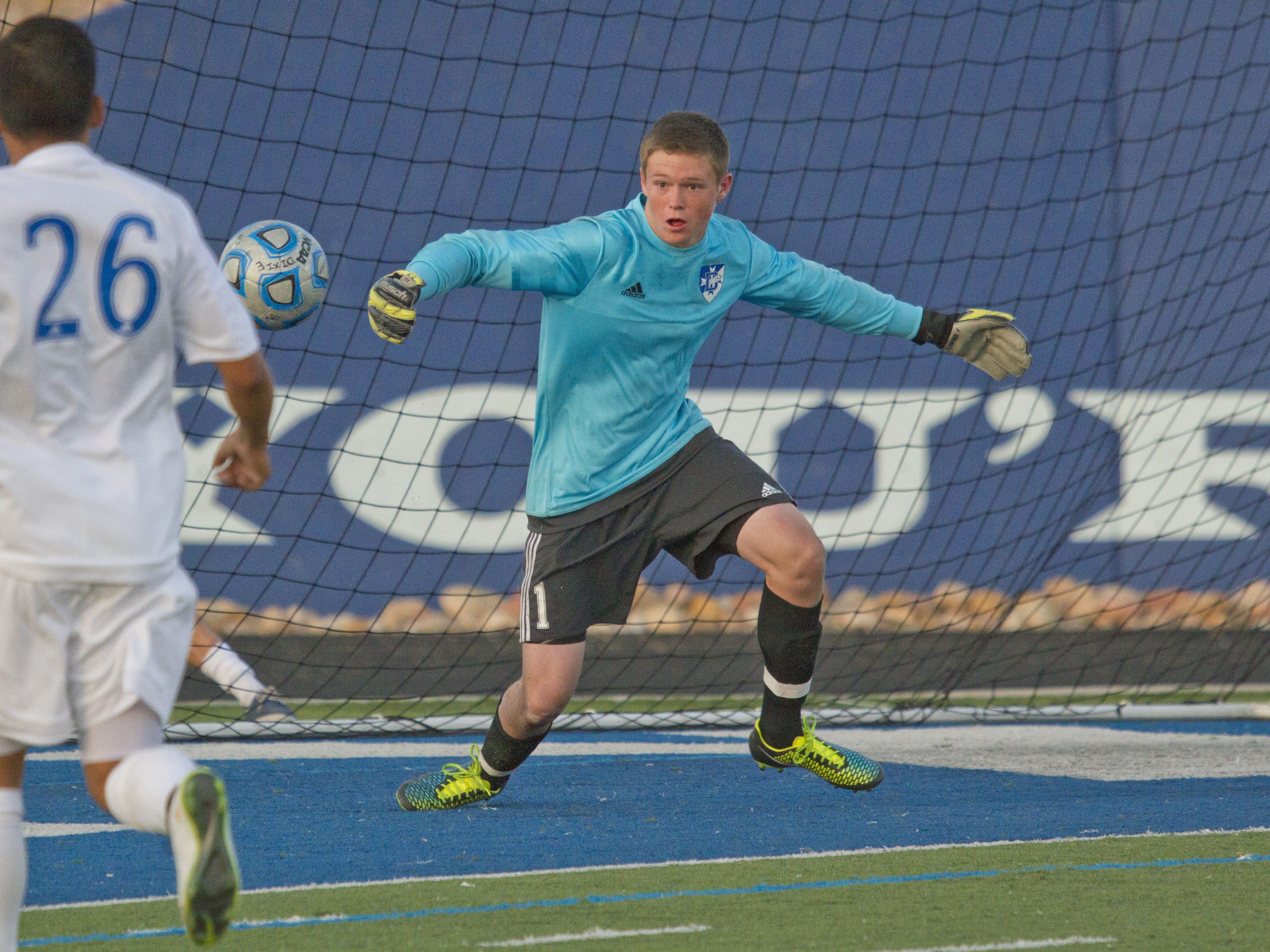 Dixie goalkeeper Bridger Wright blocks a Desert Hills shot Tuesday in St. George.