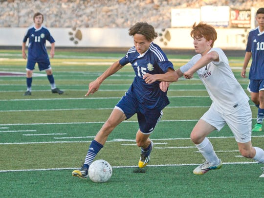 Snow Canyon forward Colton Atkin brings the ball upfield against Pine View on Friday.
