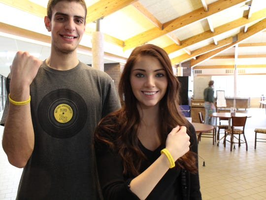 "Mid-State Technical College students brandish ""Isaac Strong"" bracelets in support of a Stevens Point fifth-grader who was diagnosed with bone cancer."
