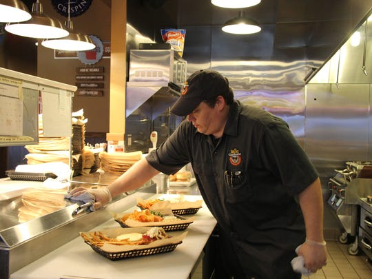 A cook prepares orders at Mr. Brews Taphouse, which will open for business in Plover in March.