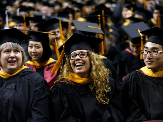 Florida State University graduates are all smiles during Friday's ceremony at the Civic Center.