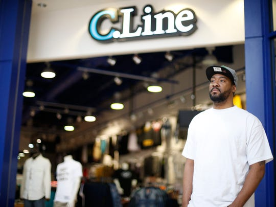 Ryan James, manager of C.Line at the Tallahassee Mall, stands in front of his store on Monday, March 2, 2015.