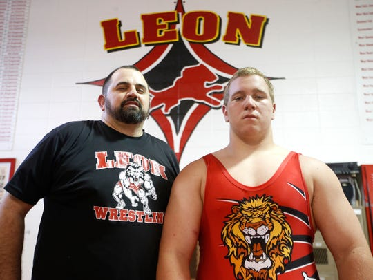 Wrestler of the Year Gabe Beyer with his coach at Leon High School, Coach of the Year Chuck Ringel.