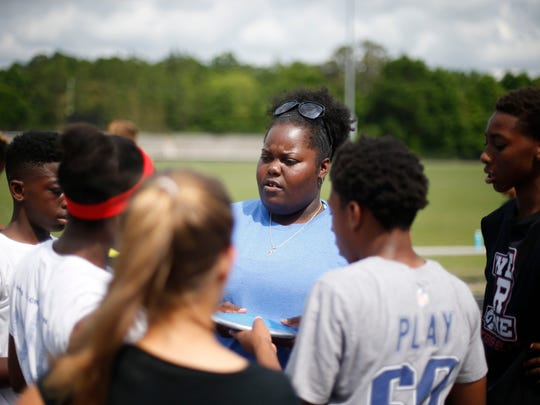Florida High track coach April McGriff talks to her team during practice at the high school on Tuesday April 14, 2015.