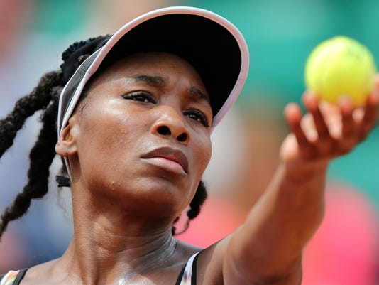 Venus Williams of the US serves the ball during the first round match of the French Open tennis tournament against Switzerland's Belinda Bencic at the Roland Garros stadium, in Paris, France, Sunday, May 25, 2014. (AP Photo/David Vincent)