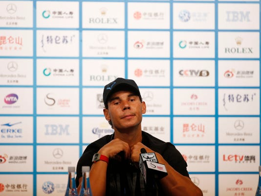 Rafael Nadal of Spain listens to a question during a press conference at the China Open Tennis Tournament in Beijing, Saturday, Sept. 27, 2014. (AP Photo/Vincent Thian)