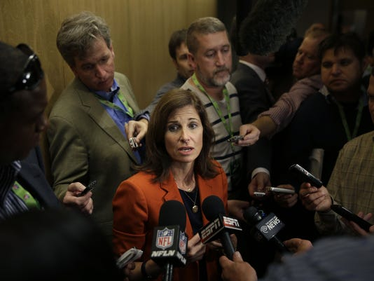 Lisa Friel, vice president of the Sexual Misconduct Consulting & Investigations division for T&M Protection Resources, talks with reporters during a meeting of NFL owners and executives in New York, Wednesday, Oct. 8, 2014. Friel is one of the advisers helping the NFL develop and carry out a domestic violence educational program. (AP Photo/Seth Wenig)