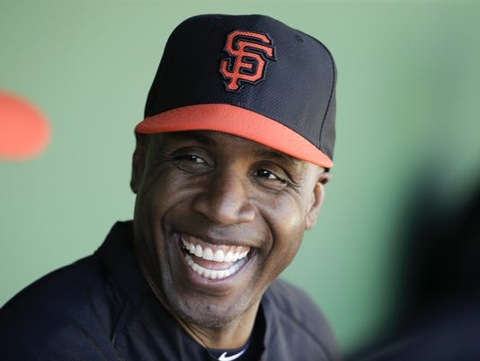 FILE - In this March 10, 2014, file photo, former San Francisco Giants Barry Bonds chats to the dugout during a spring training baseball game in Scottsdale, Ariz. Bonds' obstruction of justice conviction reversed by 9th US Circuit Court of Appeals on Wednesday, April 22, 2015.  (AP Photo/Chris Carlson, File)
