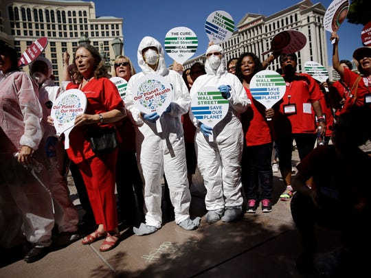 Nurses protest along Las Vegas Boulevard Wednesday, Sept. 24, 2014, in Las Vegas. Nurses in town for the California Nurses Association and National Nurses Organizing Committee convention protested on the Strip because they say U.S. hospitals aren't ready for an Ebola outbreak. (AP Photo/John Locher)