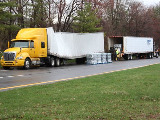 The damaged tractor trailer that got stuck under the
