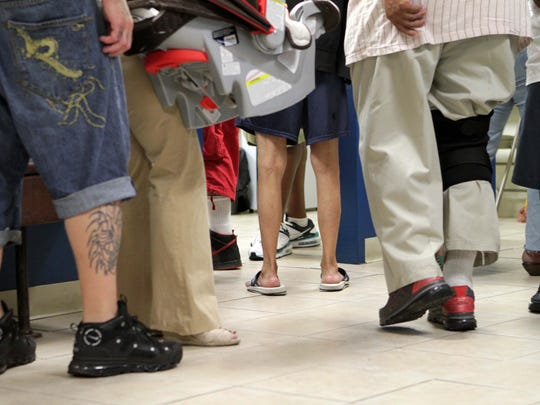 Patients line up to get a daily dose of methadone at Brandywine Counseling & Community Services on Monday, July 14, 2014.