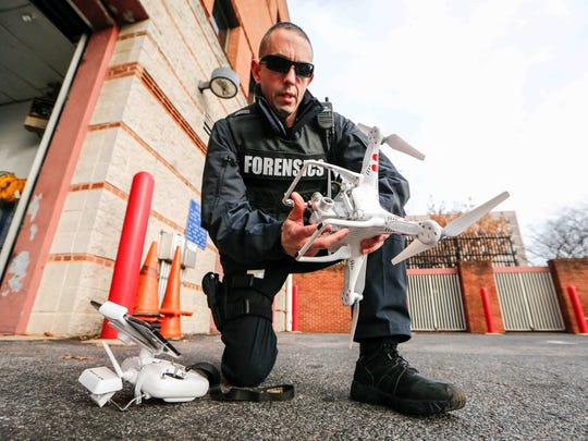 Master Sgt. Adam Ringle, head of the Forensic Services Unit, demonstrates the use of the quadcopter now being used by the Wilmington Police Department to take aerial photos and video of crime scenes.
