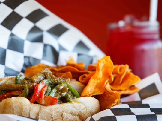 V-Steak, a vegan version of a cheesesteak, is served with Refresh Tea at Drop Squad Kitchen.