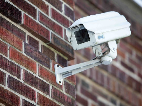 Surveilance cameras can be seen around Rose Hill Community Center near New Castle, which remains closed on Tuesday.