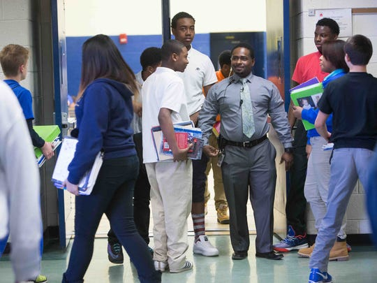 Terrance Newton, who is the assistant principal at H.B. du Pont Middle School, directs students between classes.