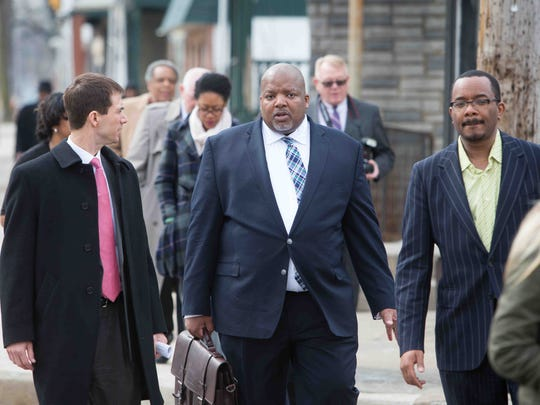 John Banks (center), deputy director with the U.S. Small Business Administration, along with state and city officials, do a walking tour of several businesses in the Southbridge neighborhood as part of a pilot program to promote small businesses in the Harriet Tubman Underground Railroad Byway.