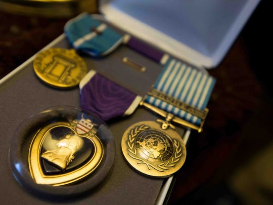 Frank Whildin's Purple Heart and Bronze Star are shown. The Korean War veteran struggled with extreme seizures and chronic obstructive pulmonary disease.