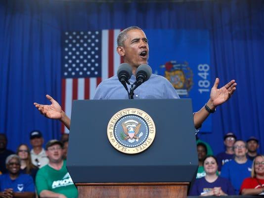-MANBrd_09-02-2014_Herald_1_A001~~2014~09~01~IMG_Obama_Tilk_copy.jpg_1_1_RE8.jpg