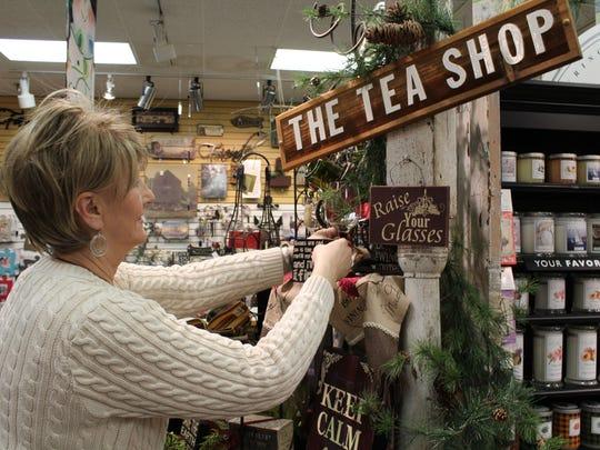 Debbie Ulman tidies up a display at The Tea Shop in