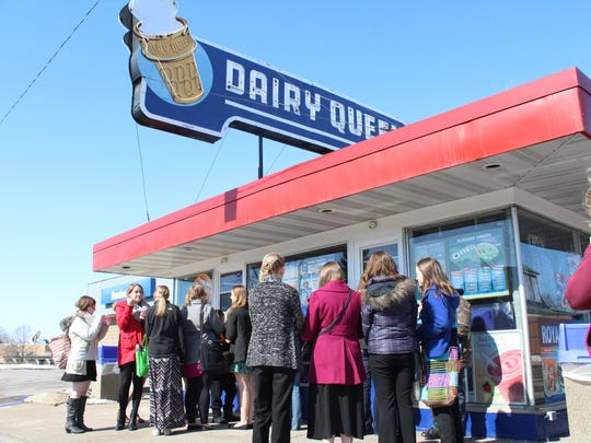 Roughly 15 people crowded around the Dairy Queen in Wisconsin Rapids Saturday.