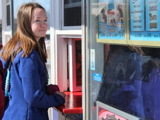 A girl orders ice cream at the Wisconsin Rapids Dairy Queen on Saturday afternoon.