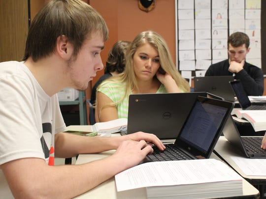 Lincoln High School seniors Brady Haugh, left, and Rachel Sneen, work on their Chromebooks in class on March 13, 2015.