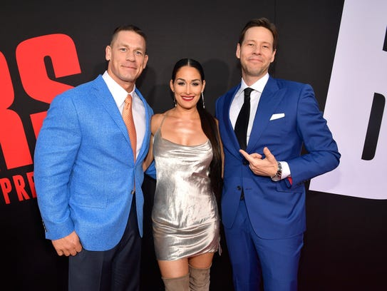 Actor Ike Barinholtz posed with John Cena and wrestler Nikki Bella.