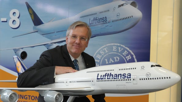 Lufthansa CEO Christoph Franz poses with a model of Lufthansa's new 747-8 at Washington Dulles following the maiden passenger flight of the jet from Frankfurt.