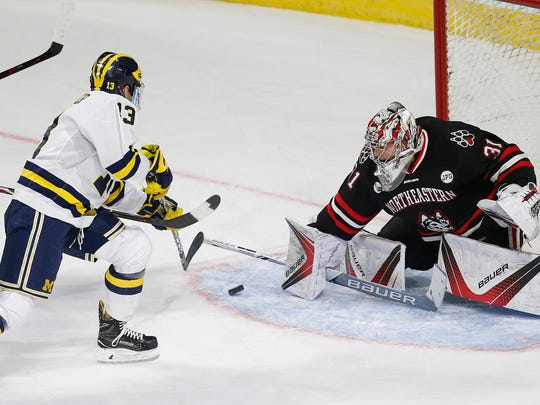 Northeastern's Cayden Primeau moves to block a shot from Michigan's Jake Slaker during the first period of an NCAA northeast regional in Worcester, Mass., Saturday, March 24, 2018.