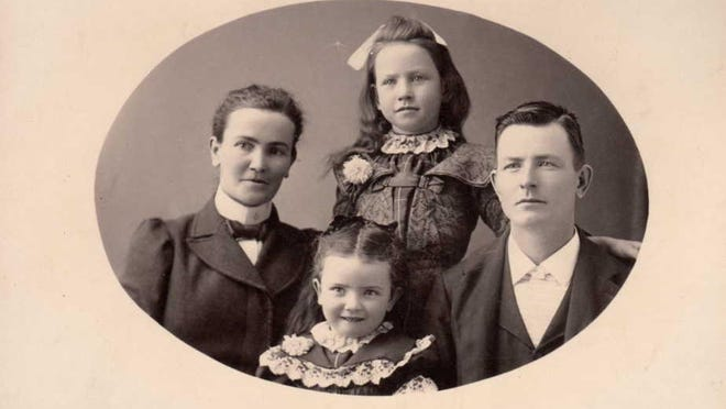 John and Lillie Crawford are seen with their daughters Edna (back) and Beatrice (front).