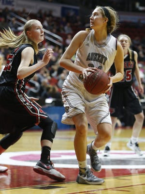 Ankeny Centennial's Tasha Vipond (34) turns to shoot over Cedar Falls Friday. She scored a team-high 17 points to help her team advance to the state final.