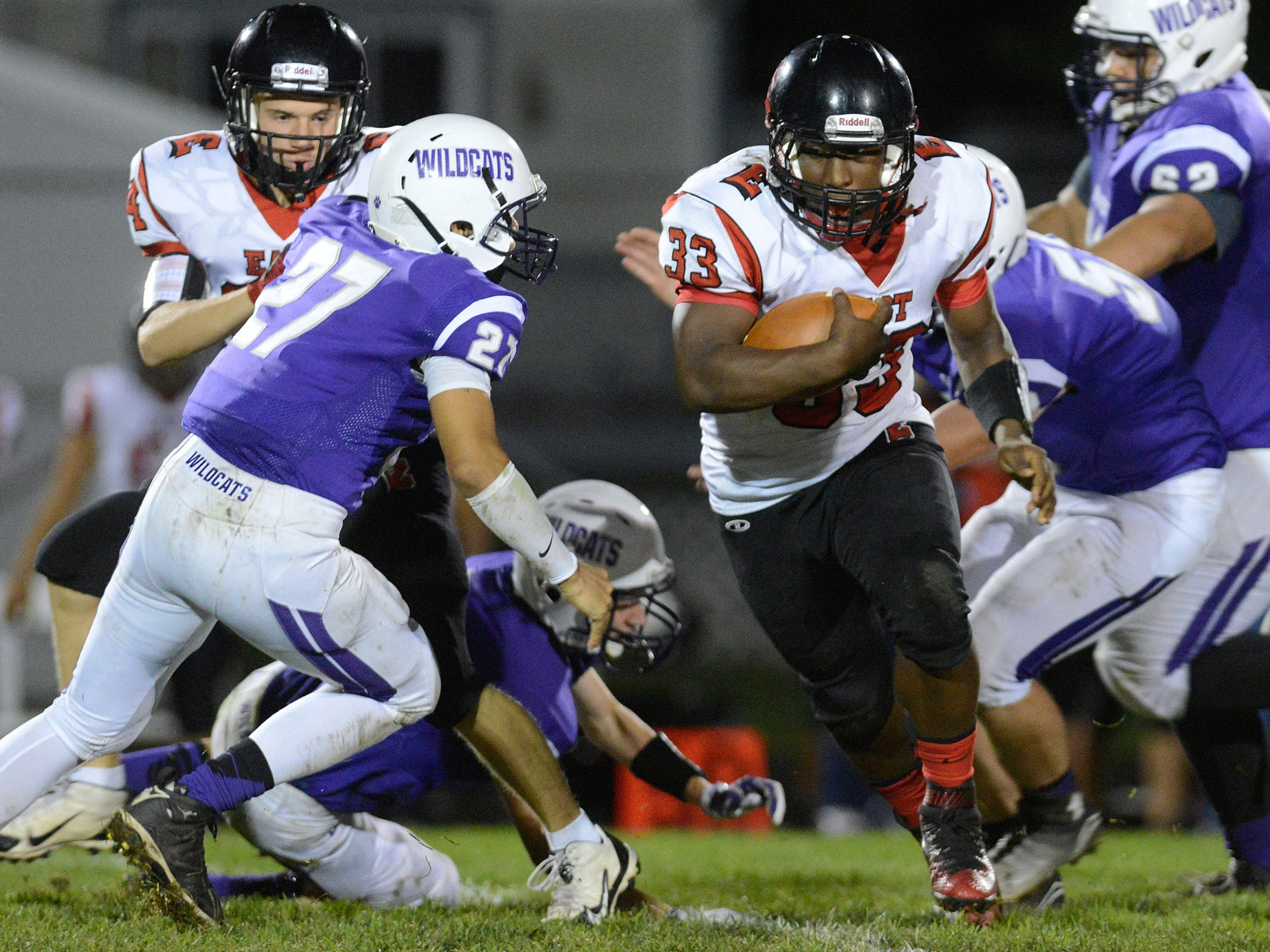 Green Bay East's Austin Short fights for more yardage as Green Bay West's Brandon Dudley closes in a Bay Conference game on Sept. 18. West and East moved from the Fox River Classic Conference to the Bay Conference.