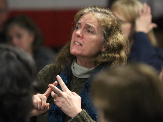 Patricia Compton of Somers asks a question during a
