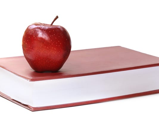 Book and apple