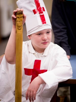 Kaiden Wilhite waits his turn to present as Pope Urban II in Rebekah Hodges' sixth grade class at Thompkins Middle School Wednesday morning. The 6th-graders created a Middle Ages and Renaissance era living museum in the school's library.