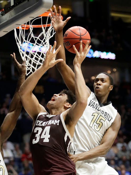 Texas A&M center Tyler Davis (34) shoots as Vanderbilt forward Clevon Brown (15) tries to block during the second half of an NCAA college basketball game at the Southeastern Conference tournament Thursday, March 9, 2017, in Nashville, Tenn. Vanderbilt won 66-41. (AP Photo/Wade Payne)