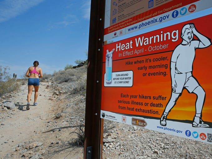Melodie Baldwin braves the heat to hike Tuesday, June