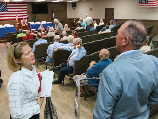 Anderson County Council members Tommy Dunn (right) and Cindy Wilson (left), talk before a forum about a proposed 2 percent hospitality tax, held at Concord Community Church in Anderson.