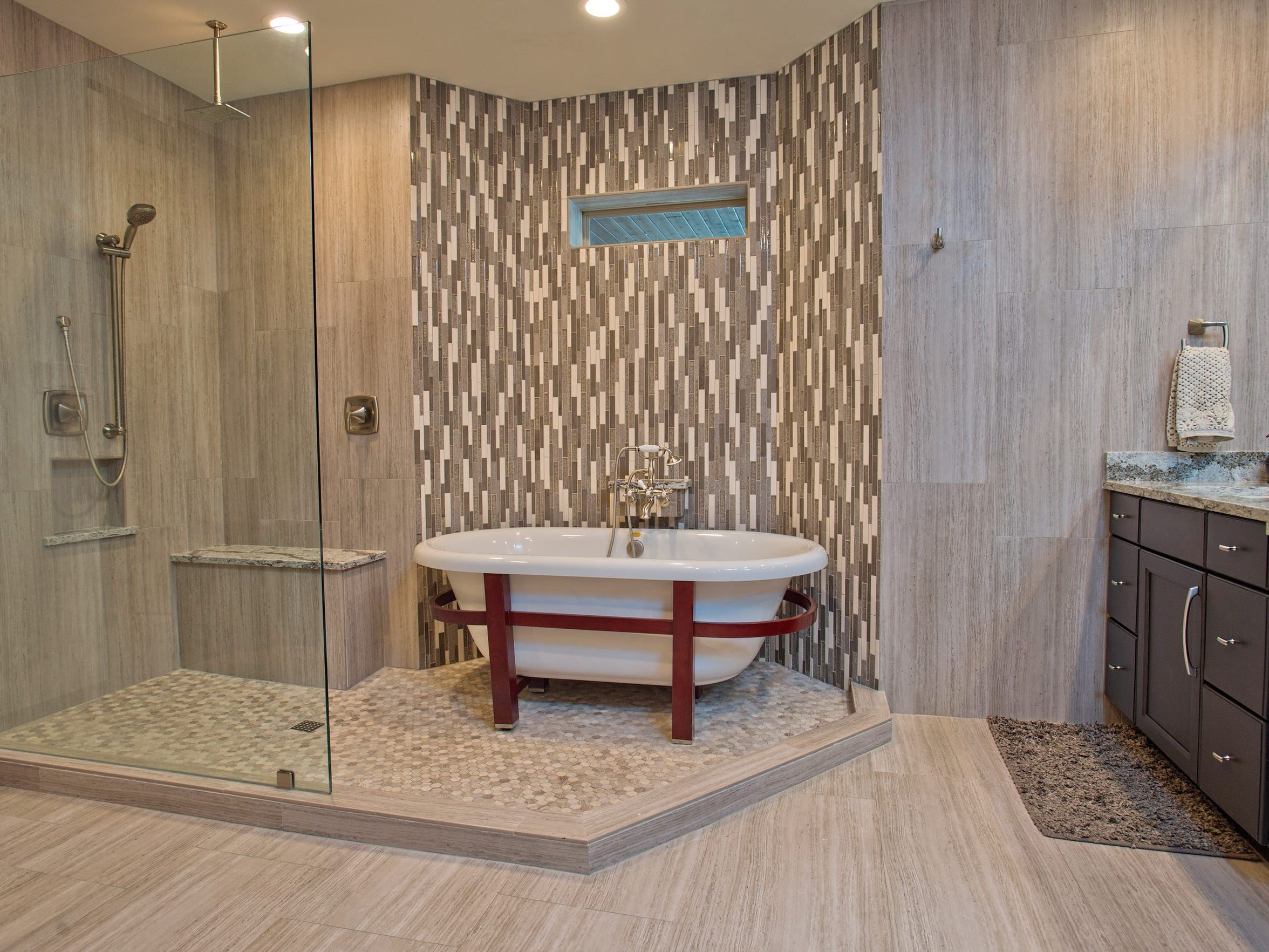 A unique shower and bath tub set up in the extra spacious master bath