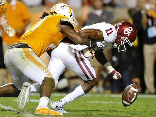 Jalen Reeves-Maybin makes one of his career-high 21 tackles in Saturday's double-overtime loss to Oklahoma.