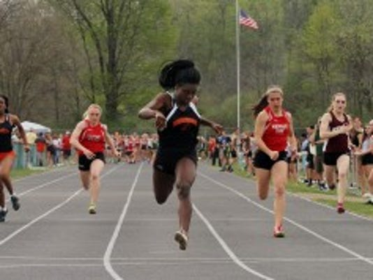 Hackettstown's Nioami Miranda wins the 100 meters at the NJAC Small-School Championships. Bob Karp/Staff Photographer.