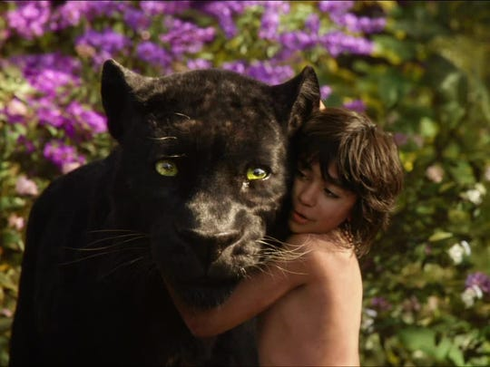 Mowgli (Neel Sethi) hugs Bagheera the panther. Sethi acted with puppets replaced by CG creatures in the final film.