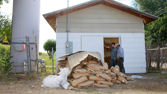 Work continues on a filtration system in the Harvest Gold water system east of Bloomfield on Tuesday.