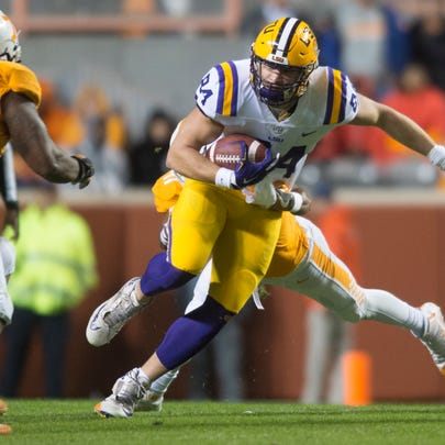 LSU tight end Foster Moreau (84) runs the ball during