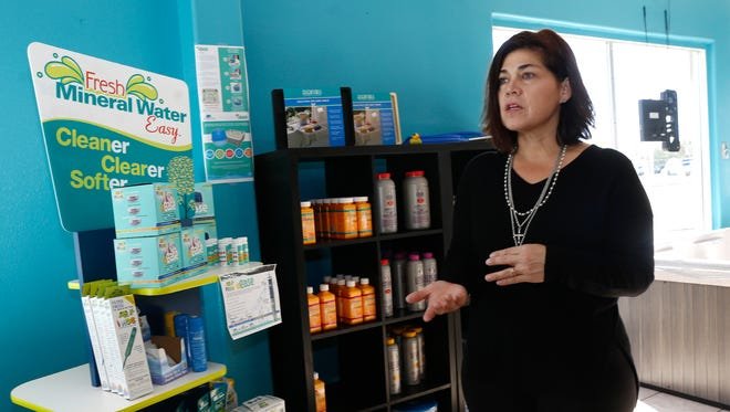 Lynn Howell, the owner of Sunset Spas, talks on Monday about the products and services the new Farmington business offers.